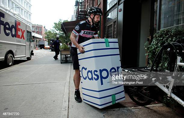Josh Weitzner owner of Samurai Messenger Service prepares to deliver a packaged mattress from the bed delivery company Casper in Manhattan NY on...
