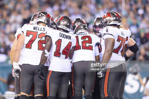 Josh Wells, Chris Godwin, Tom Brady, and Tristan Wirfs of the Tampa Bay Buccaneers huddle against the Philadelphia Eagles at Lincoln Financial Field...
