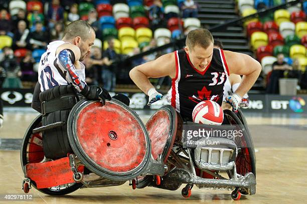 Josh Wheeler of The USA crashes into Zach Madell of Canada during the 2015 BT World Wheelchair Rugby Challenge Final match between Canada and USA at...