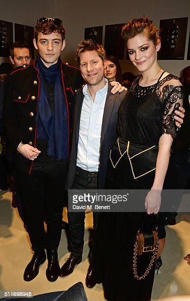Josh Whitehouse Christopher Bailey and Amber Anderson pose backstage wearing Burberry at the Burberry Womenswear February 2016 Show at Kensington...