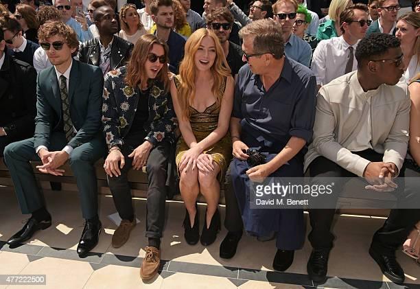 Josh Whitehouse Oscar Tuttiett Clara Paget Mario Testino and John Boyega sit in the front row at Burberry Menswear Spring/Summer 2016 show at...