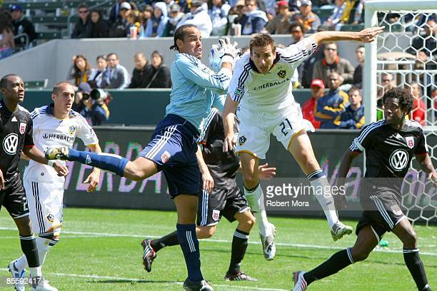 Josh Wicks of DC United saves a pass to forward Alan Gordon of the Los Angeles Galaxy during the MLS game at Home Depot Center on March 22 2009 in...
