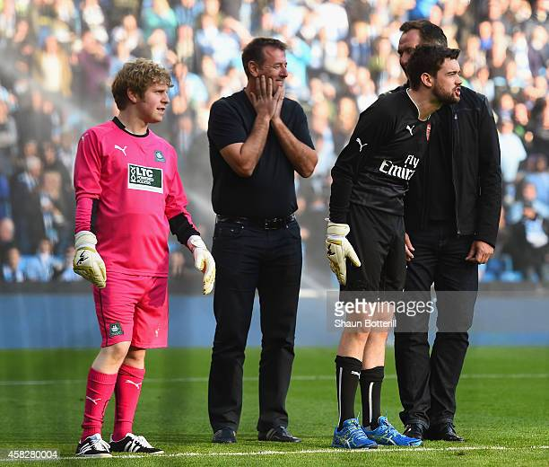 Josh Widdicombe Matt Le Tissier Jack Whitehall and David Seaman take part in half time activities during the Barclays Premier League match between...
