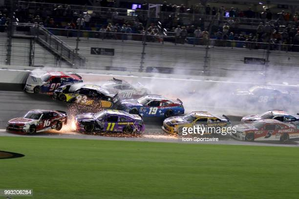 Josh Williams Cole Custer and Jeff Green Ryan Reed and Ryan Truex crash on the front stretch taking out a large part of the field CocaCola...