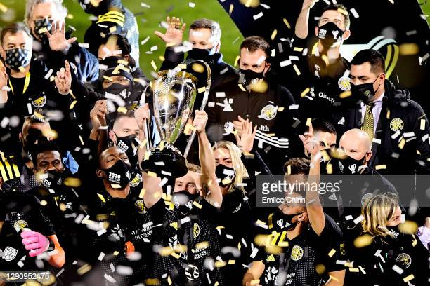 Josh Williams of Columbus Crew celebrates with the MLS Cup after a 3-0 win over the Seattle Sounders during the MLS Cup Final at MAPFRE Stadium on...