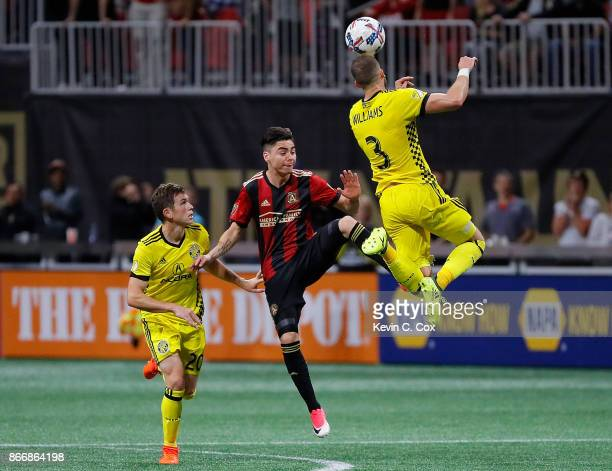 Josh Williams of Columbus Crew wins a header against Miguel Almiron of Atlanta United during the Eastern Conference knockout round at MercedesBenz...