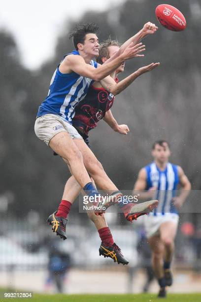 Josh Williams of North Melbourne leaps for the ball during the VFL round 14 game between the Casey Demons and North Melbourne at Casey Fields in...