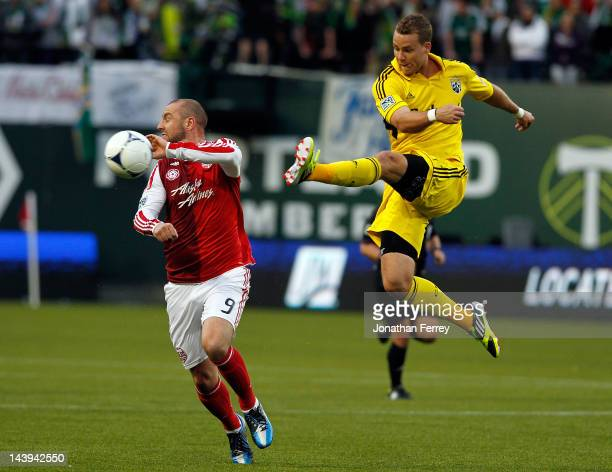 Josh Williams of the Columbus Crew clears the ball against Kris Boyd of the Portland Timbers of the Columbus Crew at JeldWen Field on May 5 2012 in...
