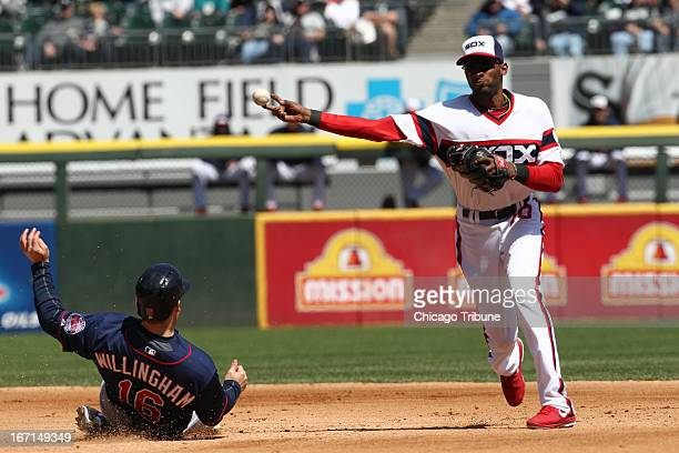 Josh Willingham of the Minnesota Twins is out at second base Alexei Ramirez of the Minnesota Twins turns a double play during the 4th inning at...