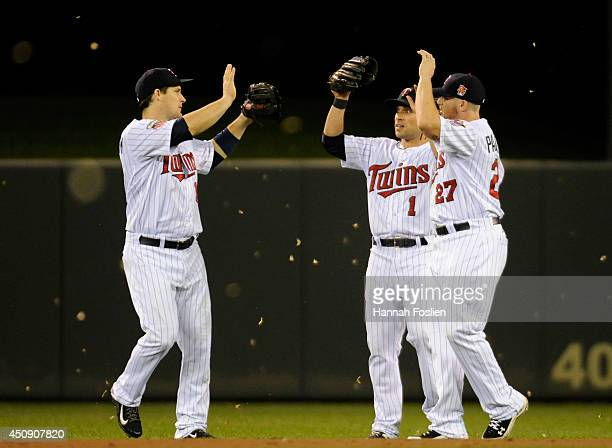 Josh Willingham, Sam Fuld and Chris Parmelee of the Minnesota Twins celebrate a win of the game against the Chicago White Sox on June 19, 2014 at...