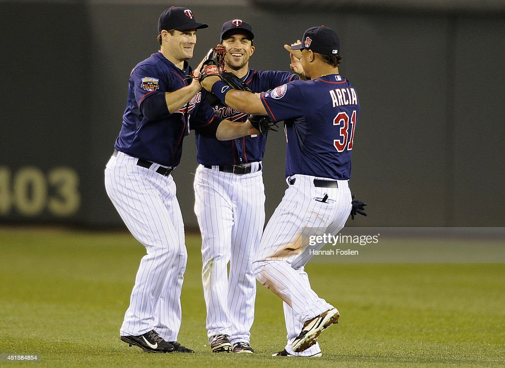 Josh Willingham #16, Sam Fuld #1 and Oswaldo Arcia #31 of the Minnesota Twins celebrate a win of the game against the Kansas City Royals on July 1, 2014 at Target Field in Minneapolis, Minnesota. The Twins defeated the Royals 10-2.
