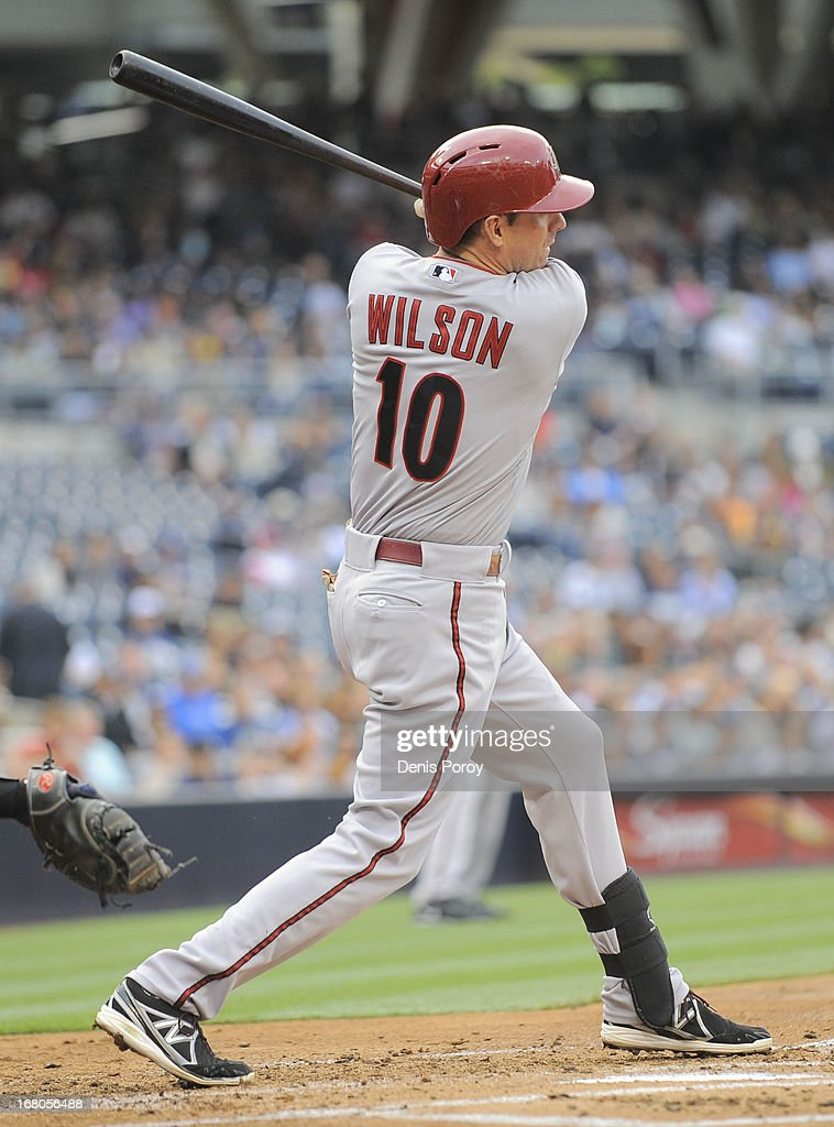 Josh Wilson #10 of the Arizona Diamondbacks hits an RBI single during the first inning of a baseball game against the San Diego Padres at Petco Park on May 4, 2013 in San Diego, California.