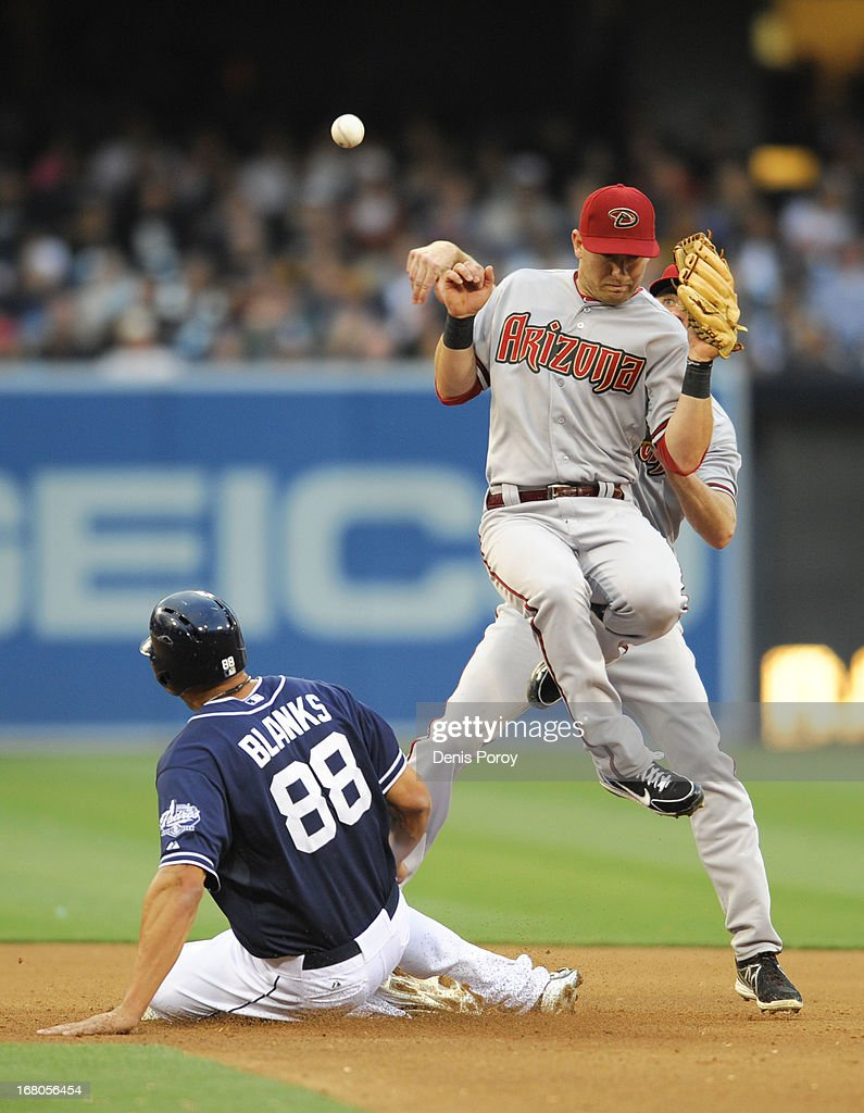 Josh Wilson #10 of the Arizona Diamondbacks manages to throw over Cliff Pennington #4 to turn a double play as Kyle Blanks #88 of the San Diego Padres is forced out at second base during the fourth inning of a baseball game at Petco Park on May 4, 2013 in San Diego, California.
