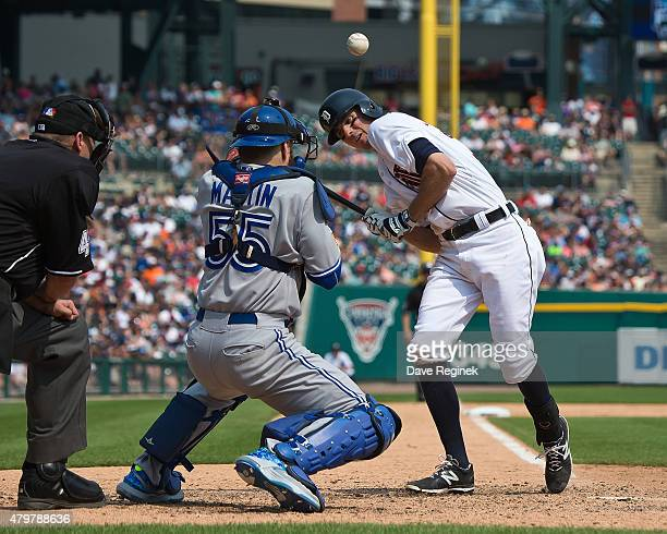 Josh Wilson of the Detroit Tigers is hit by a pitch for the second time during a MLB game against the Toronto Blue Jays at Comerica Park on July 4...