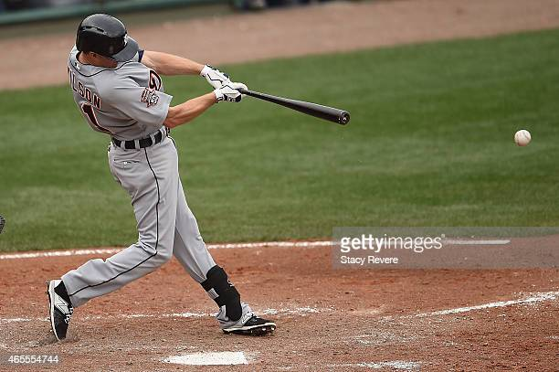 Josh Wilson of the Detroit Tigers swings at a pitch during a spring training game against the Atlanta Braves at Champion Stadium on March 7 2015 in...