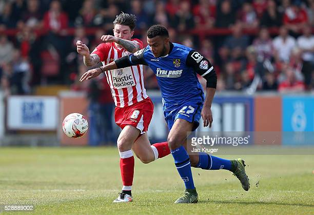 Josh Windass of Accrington Stanley battles with Ryan Johnson of Stevenage during the Sky Bet League Two match between Accrington Stanley and...