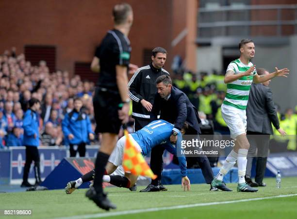 Josh Windass of Rangers is helped up by Pedro Caixinha Manager of Rangers during the Ladbrokes Scottish Premiership match between Rangers and Celtic...
