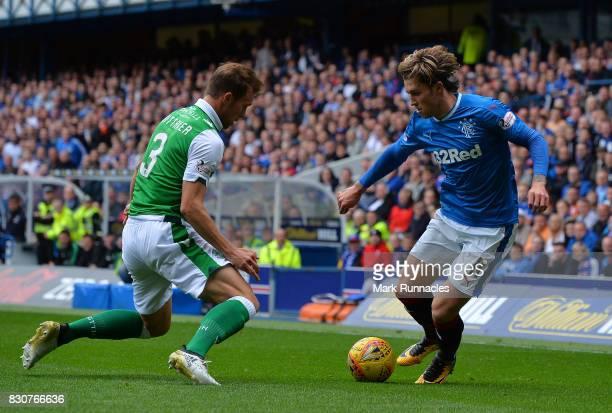 Josh Windass of Rangers takes on Steven Whittaker of Hibernian during the Ladbrokes Scottish Premiership match between Rangers and Hibernian at Ibrox...