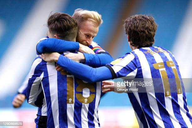 Josh Windass of Sheffield Wednesday celebrates with team mates Barry Bannan and Adam Reach after scoring their side's first goal during the Sky Bet...