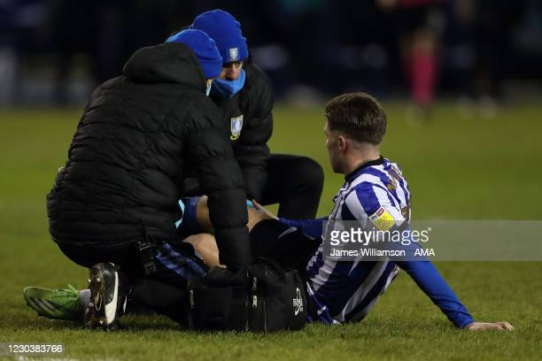 Josh Windass of Sheffield Wednesday receives treatment during the Sky Bet Championship match between Sheffield Wednesday and Derby County at...