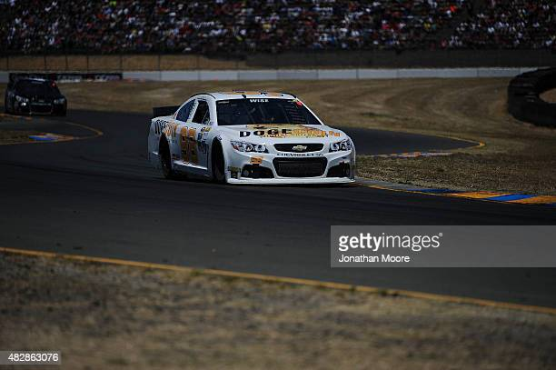 Josh Wise driver of the Dogecoin Chevrolet drives during the NASCAR Sprint Cup Series Toyota/Save Mart 350 at Sonoma Raceway on June 28 2015 in...