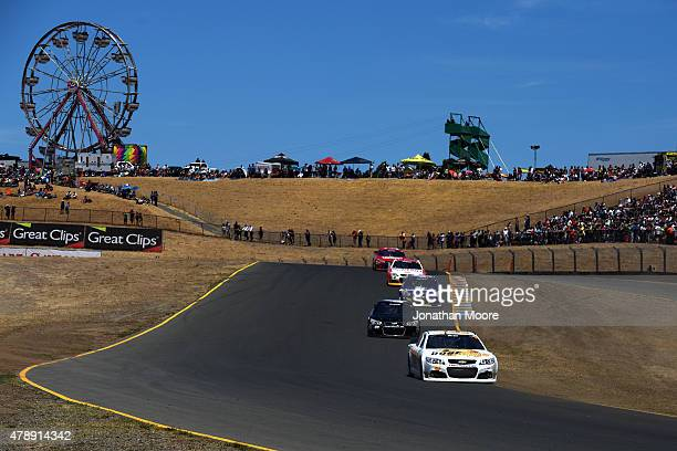 Josh Wise driver of the Dogecoin Chevrolet leads a pack of cars during the NASCAR Sprint Cup Series Toyota/Save Mart 350 at Sonoma Raceway on June 28...