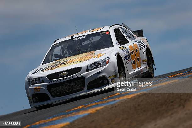 Josh Wise driver of the Dogecoin Chevrolet races during the NASCAR Sprint Cup Series Toyota/Save Mart 350 at Sonoma Raceway on June 28 2015 in Sonoma...