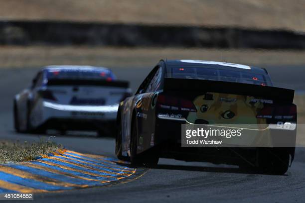 Josh Wise driver of the Dogecoin / Redditcom Chevrolet leads a pack of cars during the NASCAR Sprint Cup Series Toyota/Save Mart 350 at Sonoma...