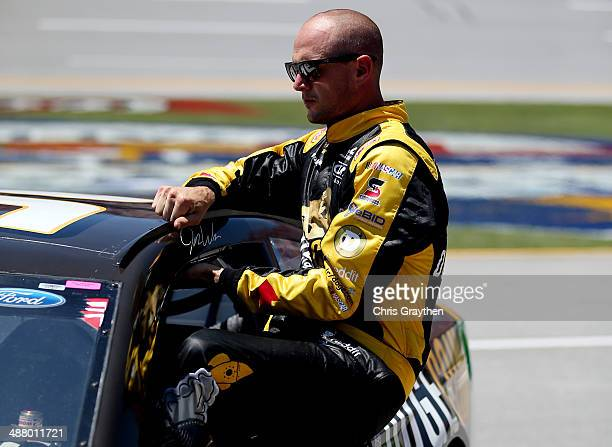Josh Wise driver of the Dogecoin / Redditcom Ford climbs from his car during qualifying for the NASCAR Sprint Cup Series Aaron's 499 at Talladega...