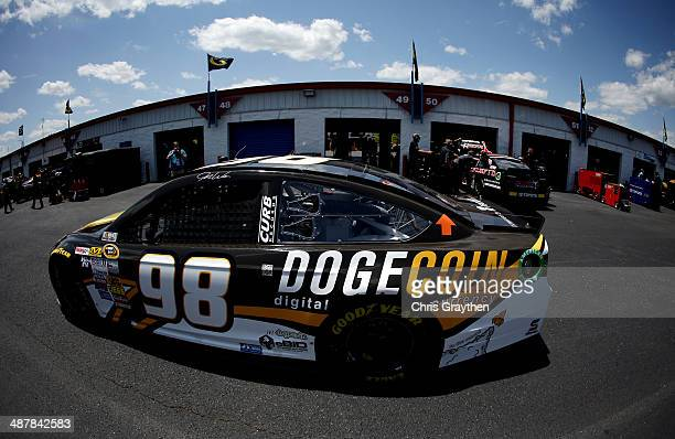 Josh Wise driver of the Dogecoin / Redditcom Ford drives through the garage area during practice for the NASCAR Sprint Cup Series Aaron's 499 at...