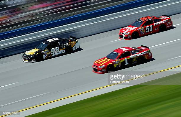 Josh Wise driver of the Dogecoin / Redditcom Ford leads a pack of cars during qualifying for the NASCAR Sprint Cup Series Aaron's 499 at Talladega...