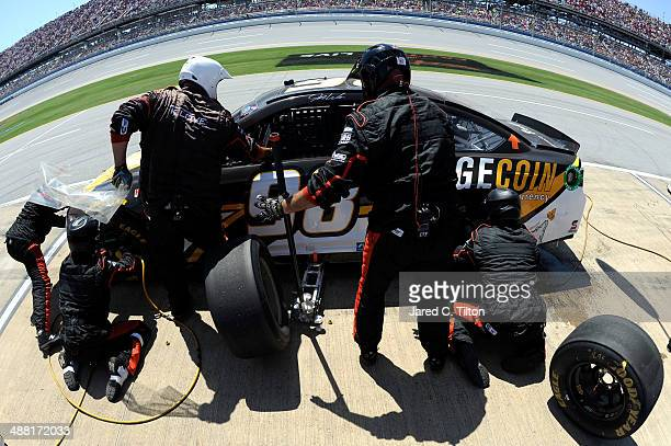 Josh Wise driver of the Dogecoin / Redditcom Ford pits during the NASCAR Sprint Cup Series Aaron's 499 at Talladega Superspeedway on May 4 2014 in...