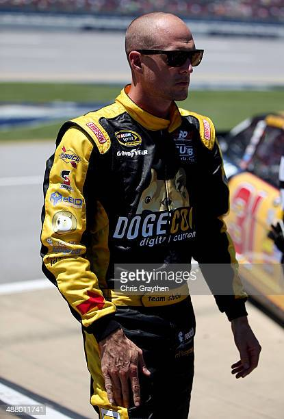 Josh Wise driver of the Dogecoin / Redditcom Ford stands on pit road during qualifying for the NASCAR Sprint Cup Series Aaron's 499 at Talladega...