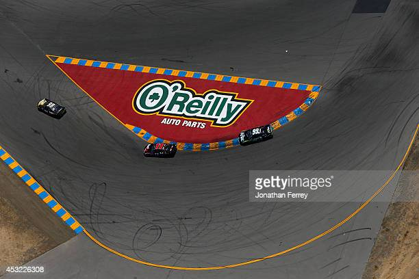 Josh Wise driver of the DogecoinRedditcom Chevrolet leads a pack of cars during the NASCAR Sprint Cup Series Toyota/Save Mart 350 at Sonoma Raceway...