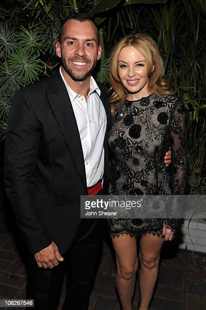 Josh Wood and singer Kylie Minogue attend the amfAR Inspiration Gala celebrating men's style with Piaget and DSquared 2 at Chateau Marmont on October...
