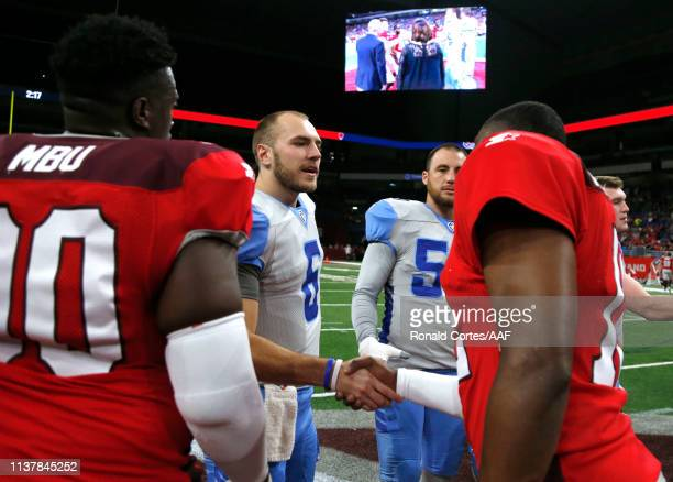 Josh Woodrum of Salt Lake Stallions greets Marquise Williams of San Antonio Commanders before their Alliance of American Football game at Alamodome...