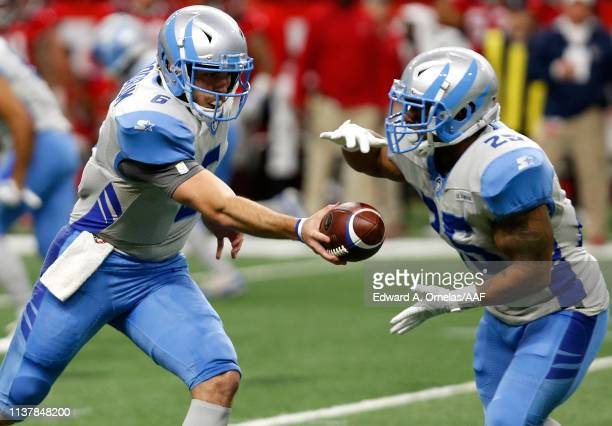 Josh Woodrum of Salt Lake Stallions hands the ball off to Luke Carrezola during the first quarter of the Alliance of American Football game against...