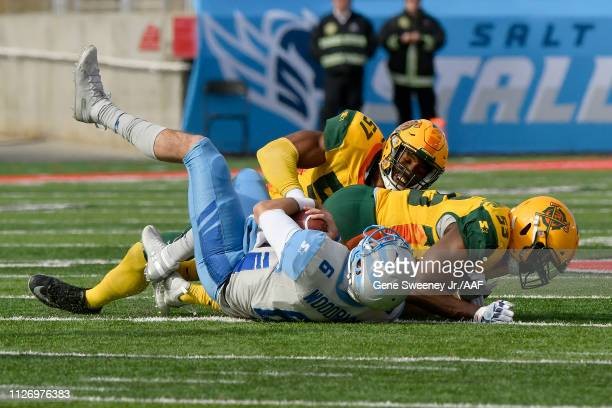 Josh Woodrum of Salt Lake Stallions is tackled by Steve Beauharnais and Obum Gwacham of Arizona Hotshots during their Alliance of American Football...
