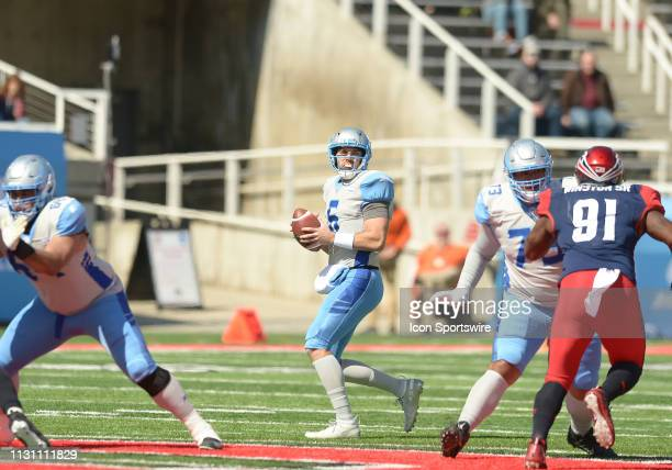 Josh Woodrum of the Salt Lake Stallions looks for an open receiver during a game between the Salt Lake Stallions and the Memphis Express on March 16...