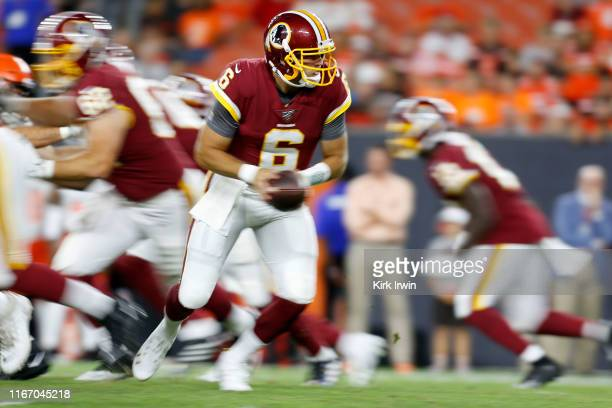 Josh Woodrum of the Washington Redskins drops back to hand off the ball during the game against the Cleveland Browns at FirstEnergy Stadium on August...