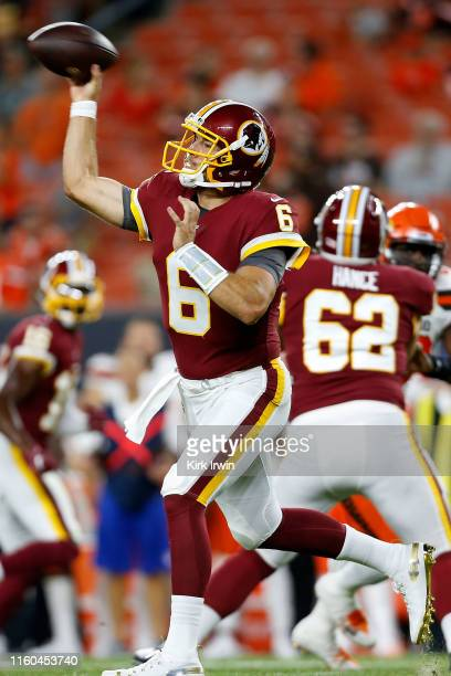 Josh Woodrum of the Washington Redskins throws a pass during the fourth quarter of the game against the Cleveland Browns at FirstEnergy Stadium on...