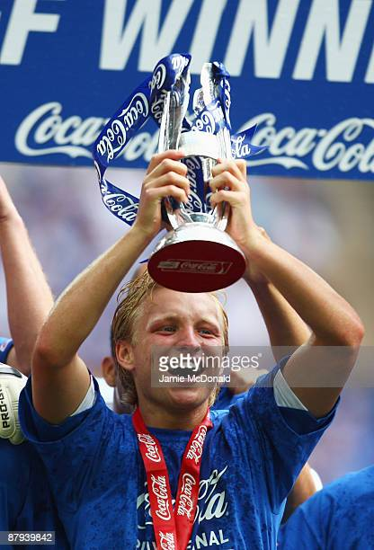 Josh Wright of Gillingham celebrates victory with the trophy following the Coca Cola League 2 Playoff Final match between Gillingham and Shrewsbury...