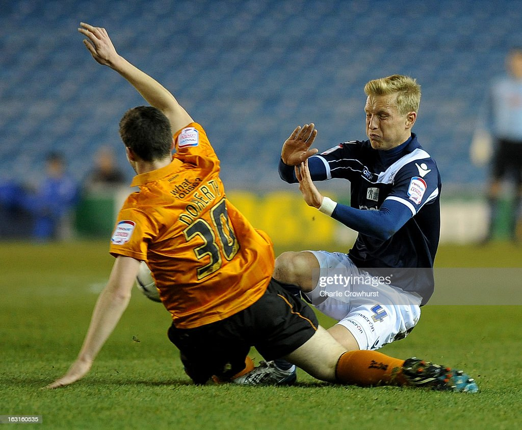 Josh Wright of Millwall clashes hard with Wolves' Matt Doherty during the npower Championship match between Millwall and Wolverhampton Wanderers at The Den on March 05, 2013 in London, England,
