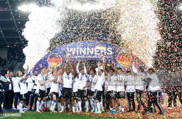 Josha Vagnoman of Germany celebrates with the UEFA European Under-21 Championship trophy following victory in the 2021 UEFA European Under-21...
