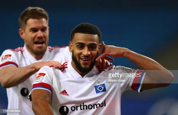 Josha Vagnoman of Hamburger SV celebrates with teammate Simon Terodde after scoring their team's fourth goal during the Second Bundesliga match...