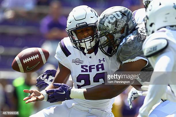 Joshawa West of the Stephen F Austin Lumberjacks is hit by Josh Carraway of the TCU Horned Frogs in the first quarter at Amon G Carter Stadium on...