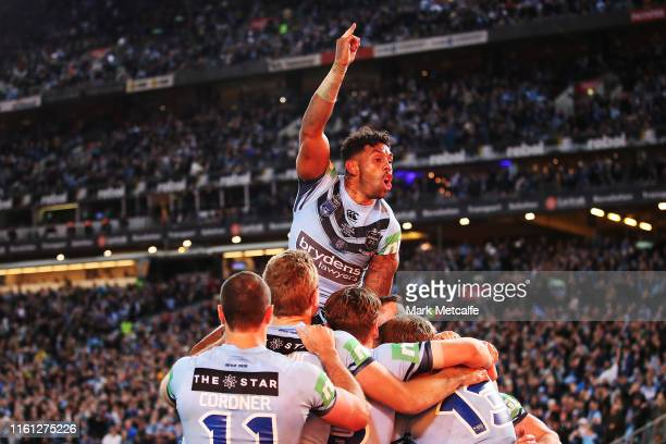Joshua AddoCarr of the Blues celebrates the try by team mate Damien Cook of the Blues during game three of the 2019 State of Origin series between...