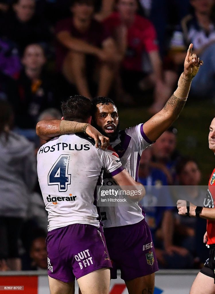 Joshua Addo-Carr (r) of the Storm celebrates after scoring a try during the round 22 NRL match between the North Queensland Cowboys and the Melbourne Storm at 1300SMILES Stadium on August 4, 2017 in Townsville, Australia.