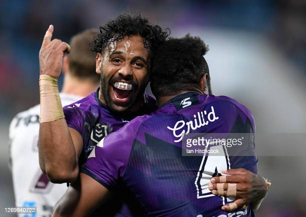 Joshua AddoCarr of the Storm celebrates the try of Justin Olam of the Storm during the round 16 NRL match between the Melbourne Storm and the Manly...