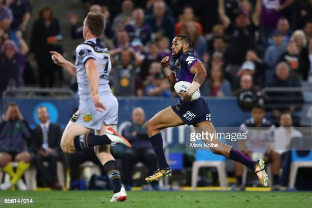 Joshua AddoCarr of the Storm makes a break during the 2017 NRL Grand Final match between the Melbourne Storm and the North Queensland Cowboys at ANZ...